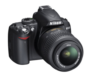 Nikon D3000 (body) and backpack