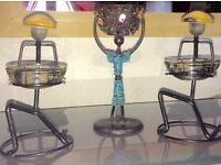 African figures candle holders x 3 .