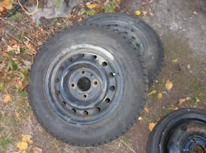 2 14inch studded winter tires w/ rims