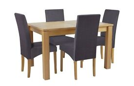 Oak Extendable Dining Table with 4 brown covered chairs. Table can be extended to seat 6.