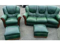 Green leather settee and one armchair + two pouffes.