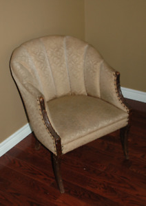 Antique, patterned toupe tufted chair with nailhead trim