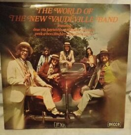 Signed by all 6 The World of the new vaudeville Band LP