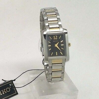 SEIKO WOMENS BLACK DIAL SILVER & GOLD SQUARE WATCH SUJG15 BAND HAS SCRATCHES