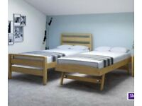 Single bed with trundle, wooden frame.