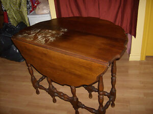 very old drop leaf table with two side panels