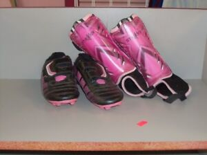 Several pair of Children Soccer Shoes and Shin Pads