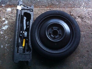 Spare tire Pontiac 5 bolt and scissor jack like new