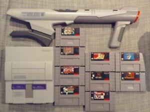 Console Super Nintendo SNES. Aussi, grande sélection de jeux.