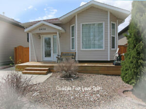 4 BEDROOM COALDALE HOME WITH WALK OUT BASEMENT!