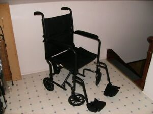 COLLAPSIBLE TRANSPORT WHEELCHAIR