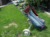Right golf clubs with bag, cart and balls $20.00