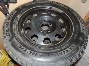Four winter tires with rims, fit our Ford Edge