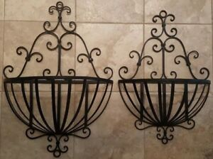 Wrought iron planters hanging