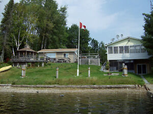 RED CEDAR LAKE - Waterfront Property for Sale: