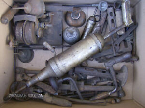 Antique oil cans and tools, 2 radios, and Tool box.