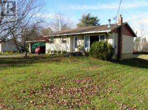 Attached garage and new deck, wood stove, 5 foot walk-in shower!