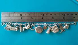 1oz 925 HALLMARKED SILVER CHARM BRACELET WITH 11 CHARMS