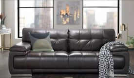 Reduced - Designer leather sofa with matching storage foot-on