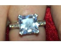 Large white topaz and crystals ring