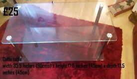 Matching Glass Coffee Table and Glass Television Corner Stand. Check the images for the dimensions