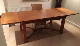 Oak Dining Table with optional leaves to seat 4-8 people