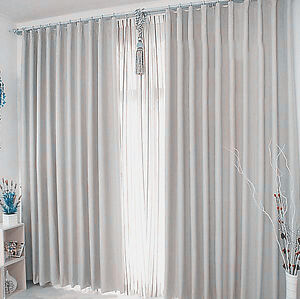 New Pair of Coated Blockout Curtains/ Liners 2x135X230cm White Colour.