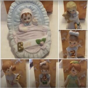 Growing Up collector figurines