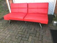 Red Leather Sofa Bed with silver legs