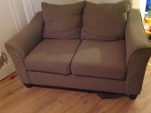 Grayish love seat, comes with beige cover. $35! No delivery