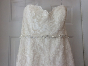 light ivory colour wedding dress, lace and beadings...