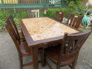 Country style table with tiles on top with six chairs