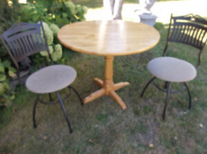 Solid wood drop leafs table with two swivel chairs