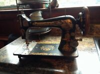 Antique black and gold singer sewing machine