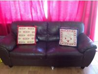3seater sofa and large red curtains