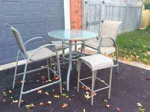 Two patio table and chair sets