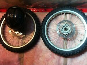 Rims and tires, bars, misc plastics off 02 cr250