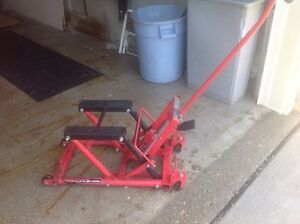 Motorcycle jack. $70.  Lifts to 14 in. Rated at 1500lb.