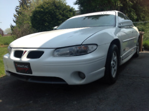 1998 White gtp coupe for sale ,good parts in it.
