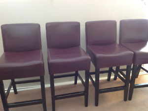 Four leather stools
