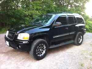 Lifted gmc envoy.. Trade for sled