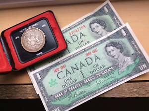 BC 1971 Silver Dollar and two $1 Centennial bills