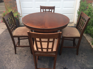 Dining table, 42 inch round with 18 inch leaf and four chairs