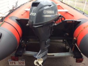 Inflatable boat/Motor/trailer