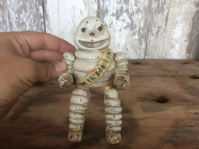 Cast Iron Michelin Tire Man Figure Glass Eyes, Sitting Position Antique