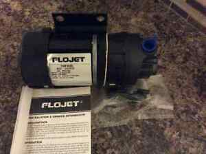 12 Volt FLOJET pump NEW HAS NEVER BEEN USED