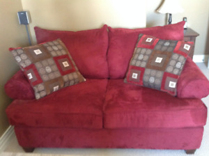 Sofa Love Seat - Red in Colour with matching decor pillows