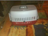 Dog/cat carrier and bed.