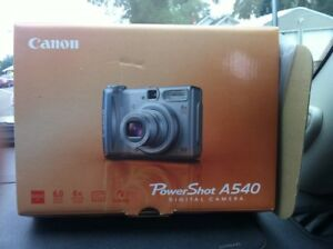 Canon camera with case and sd card for sale