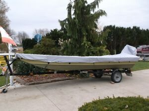 BOAT,TRAILER AND NEW MOTOR